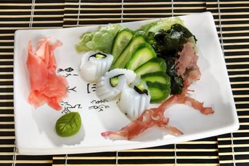 Sushi menu rolls with scallops, sliced cucumber, seaweed