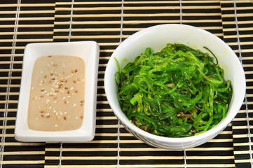 Sushi menu: salad of seaweed and sauce