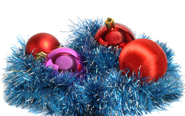 red Christmas balls on a bed of artificial rain