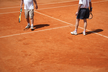 Male couple playing tennis