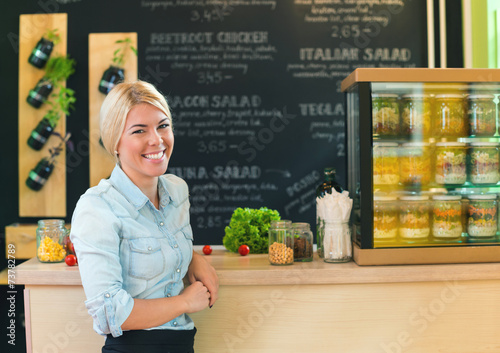 The owner of small restaurant - 73782789