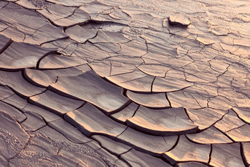Cracked ground at sunset light;