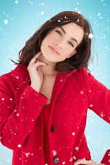 Composite image of portrait of a cheerful brunette in red coat