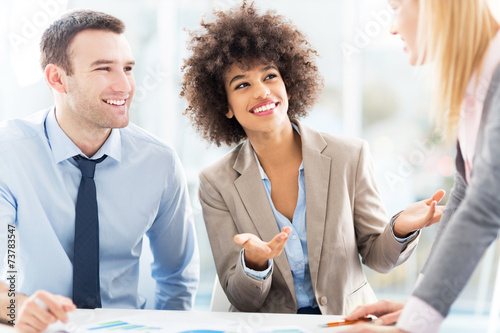 canvas print picture Young business people discussing in office