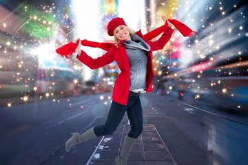 Composite image of happy blonde in winter clothes posing