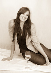 Pretty girl with glass of wine
