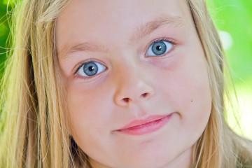Cute girl with big blue eyes