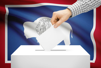 Ballot box with national flag on background - Wyoming