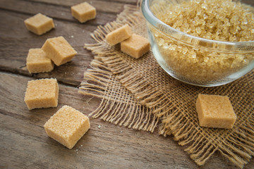 Brown sugar cubes on wooden table