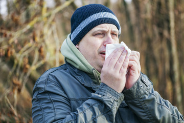 Man with napkin going to sneeze