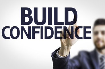 Business man pointing the text: Build Confidence