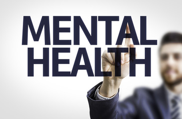 Business man pointing the text: Mental Health