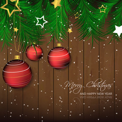 Christmas background with bauble, pine needles, wooden texture