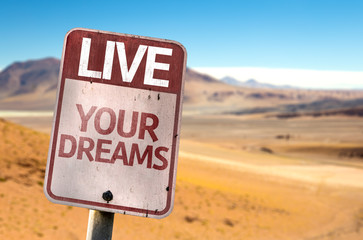 Live Your Dreams sign with a desert background