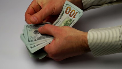 hands calculate new banknotes of dollars