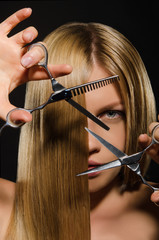 Young woman with straight hair and scissors