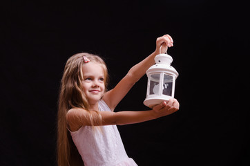 Five-year girl with candlestick in the hands of