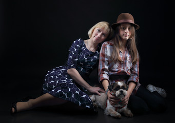 Mom and daughter with her dog