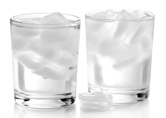 Glasses with ice cubes isolated on white