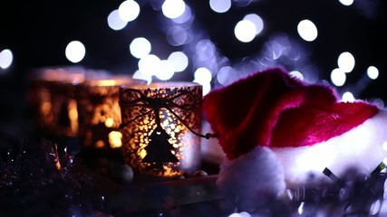 Advent, four candles decorated and Santa Claus hat
