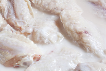 Raw Chicken Wings marinating in buttermilk