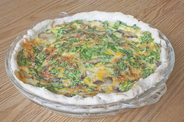 A Homemade Spinach and Mushroom Quiche Pie.