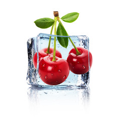 Ice cube and juicy cherries isolated on the white background