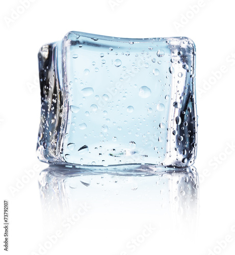Cube of blue ice isolated on a white background - 73792107