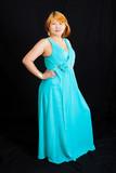 portrait of blonde lass wearing a long blue dress poster