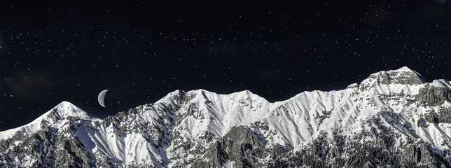 chain of mountains in winter in the night