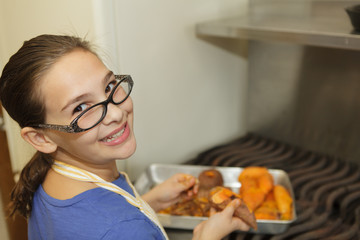 Young girl preparing sweet potatoes
