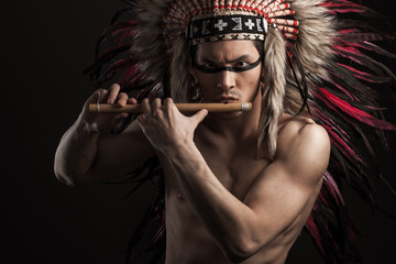 Portrait of the indian strong man posing with traditional native