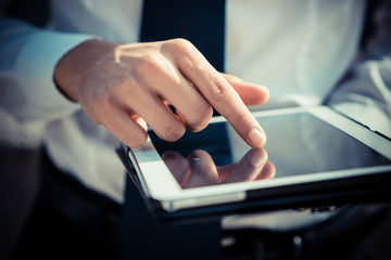 close up businessman man hand using tablet device