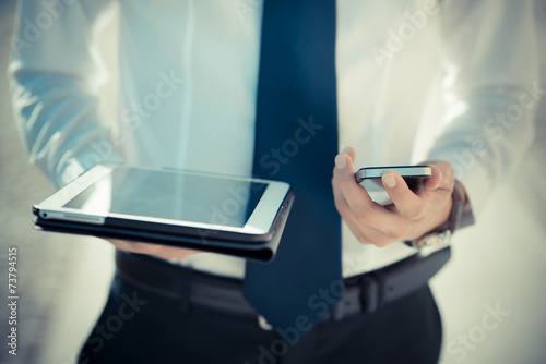 canvas print picture close up businessman man hand using tablet and smart phone
