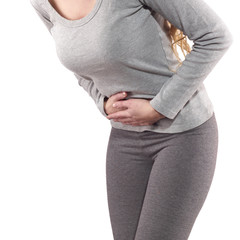 Woman with both palm around waistline to show pain belly area.