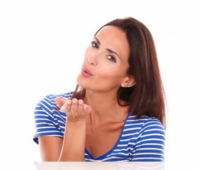 Cheerful lady in blue t-shirt blowing a kiss