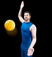 Volleyball player on blue uniform isolated on black background