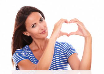Pretty hispanic in blue t-shirt with heart sign