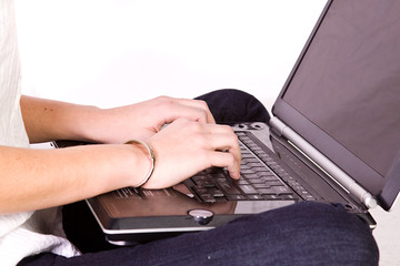Close up on a Girl's hands typing