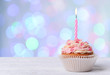 Delicious birthday cupcake on wooden table - 73796931