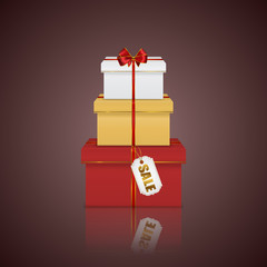 Gift boxes colorful stack tower with red ribbon, bow and tag