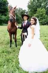 bride groom walking a horse