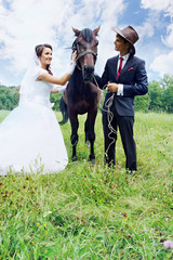 bride, groom and horse