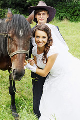 happy couple with a horse