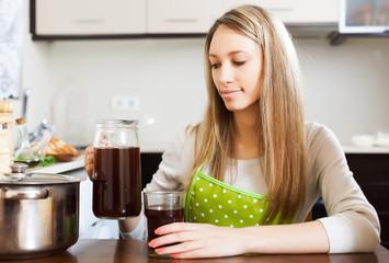 Woman with fresh kvass in jug