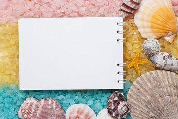 blank notepad over blue yellow pink bath salt