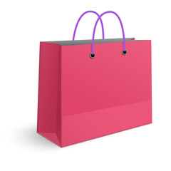Classic shopping pink bag with violet grips isolated