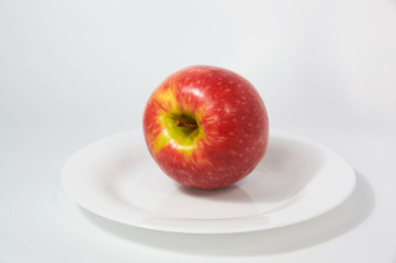 Large ripe red Apple with handle