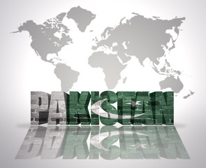 Word Pakistan on a world map background