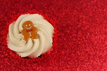 Christmas Cupcake on Red Glitter Background.